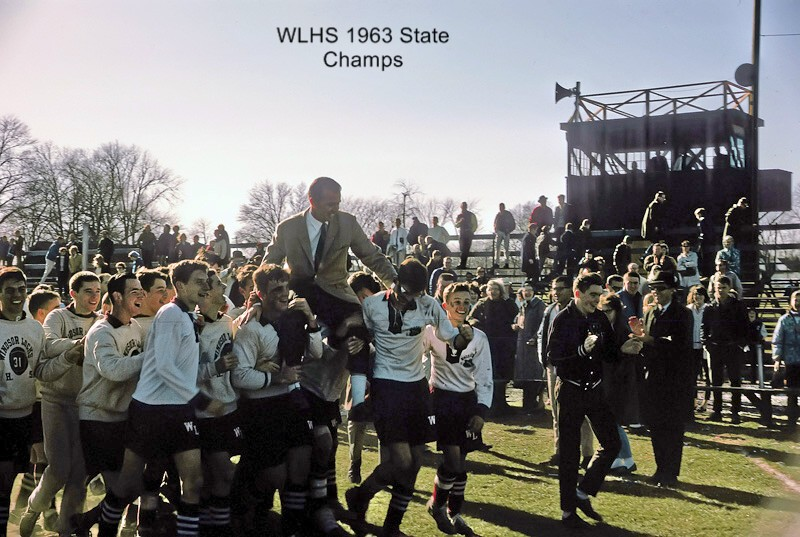 Coach Dan Sullivan hoisted on the shoulders of his 1963 team